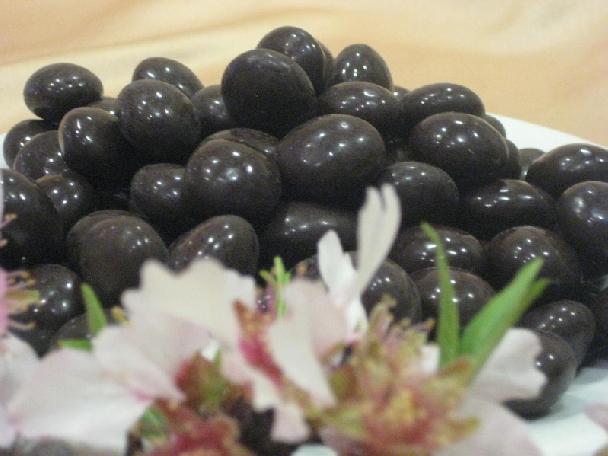 Peladillas choco. negro granel.